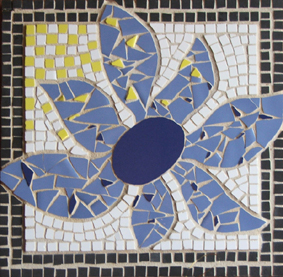 Blue Sunflower wall plaque made in 2002 at a community college course in Sydney. First attempt at mosaic making, and one I am still proud of.